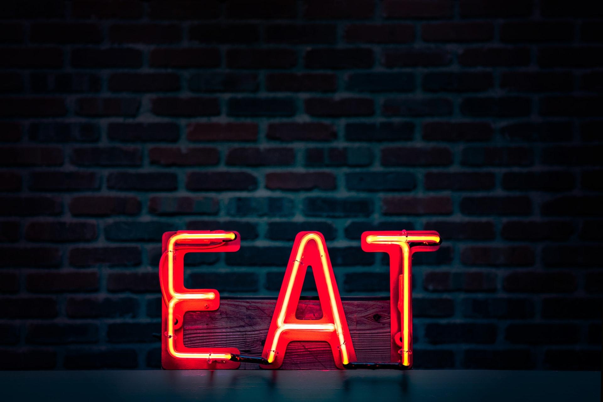 fluorescent eat sign