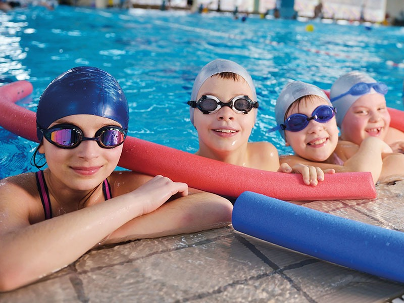 A Group Of Kids In Swimming Lesson
